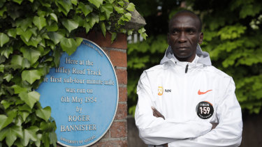 No limits: Eliud Kipchoge poses alongside a plaque commemorating Roger Bannister's four-minute mile.