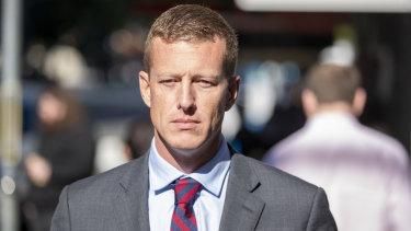 Phillip David Burton leaves the Brisbane District court in Brisbane on Tuesday.