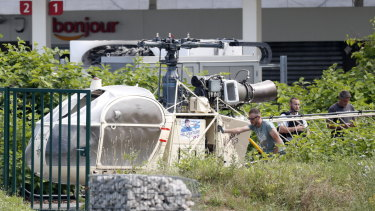 Investigators transport an Alouette II helicopter believed to have been abandoned by French prisoner Redoine Faid and suspected accomplices in July.