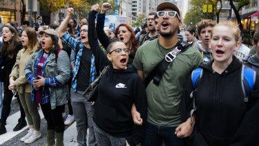 'Black Lives Matter' marchers  close down Chicago's Michigan Avenue as they  celebrate the verdict.