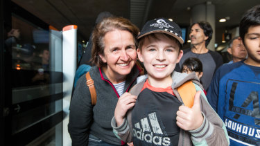 Sonya Gates and son Ryan, who queued for several hours to ride the metro trains on Sunday.