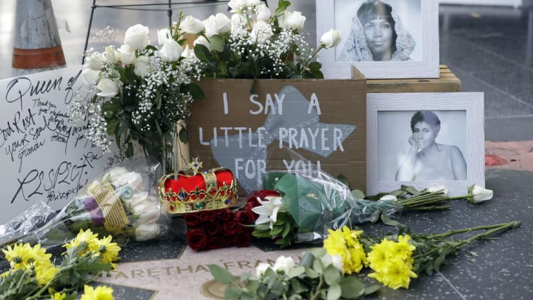 Tributes to Aretha Franklin are placed on her star on the Hollywood Walk of Fame on Thursday.
