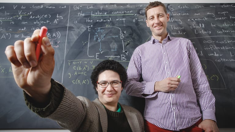 Australian National University PhD student Ivo Vekemans and Associate Professor Scott Morrison both prefer using blackboards to communicate complicated ideas to their peers.