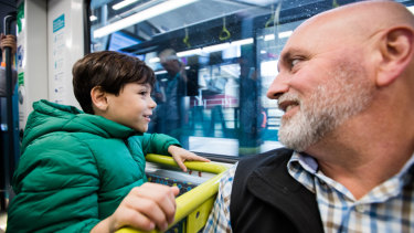 Tod Sarina and son Daniel, 7, from Windsor Downs, on a metro train.
