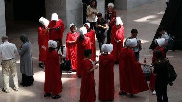 "Demonstrators protesting against Supreme Court nominee Brett Kavanaugh, wear costumes from ""The Handmaid's Tale""."