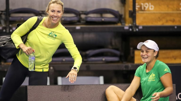 Mates: Molik and Barty relax during Fed Cup preparations last year.