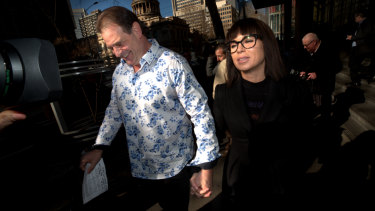 John Setka smiles as he leaves court with Emma Walters.