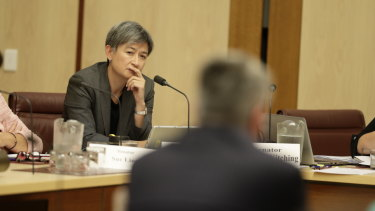 Labor senator Penny Wong listens to Finance Minister Mathias Cormann in a committee hearing on Tuesday morning.