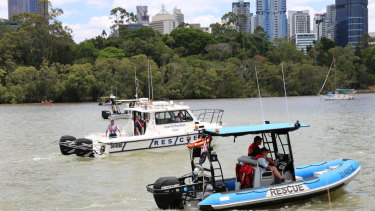 Volunteer Marine Rescue Brisbane search for a man who was reported missing after falling into the Brisbane River near the Kangaroo Point cliffs.