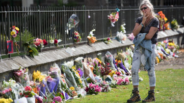 Floral tributes on the fence of the Christchurch Botanic Gardens on Saturday.