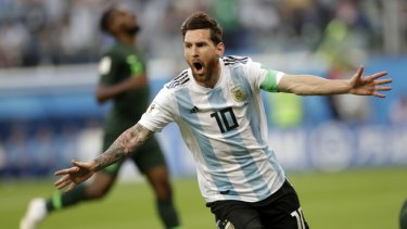 Danger man: Lionel Messi scores for Argentina against Nigeria.