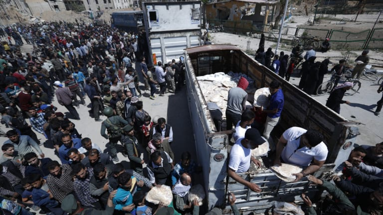 Syrian authorities distribute bread, vegetables and pasta to Douma residents.