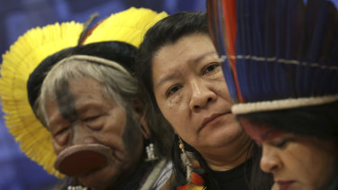 Kayapo tribe leader Raoni Metuktire, from left, Joenia Wapichana, the first Brazilian indigenous MP, and indigenous leader Sonia Guajajara meet with MPs to discuss land rights in April.