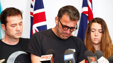Theo Hayez's father, Laurent, with Theo's godfather Jean-Philippe Pector and cousin Lisa Hayez during the emotional press conference in Byron Bay.