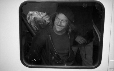 Edwin Drummond smiles while in custody on a New York Police Department boat on May 11, 1980.