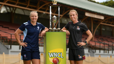 What they're fighting for: NSW skipper Alyssa Healy and Queensland Fire captain Kirby Short with the WNCL trophy.