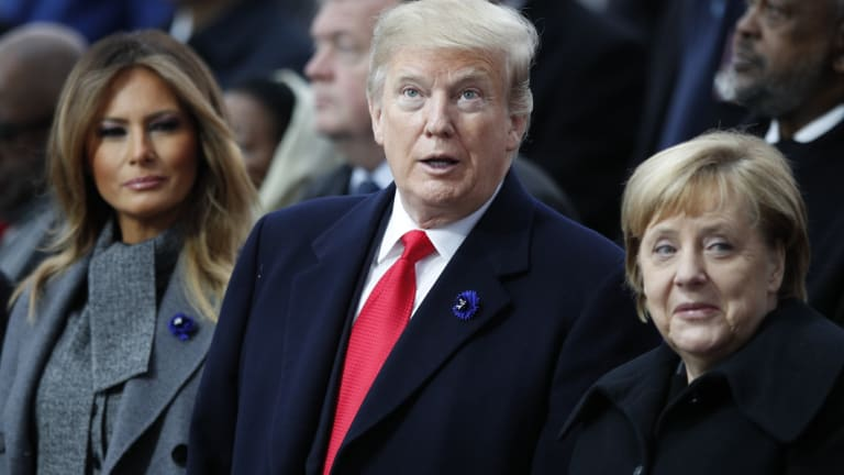 German Chanellor Angela Merkel, right, with Donald Trump and his wife Melania.