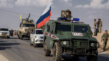 Kurdish forces withdraw from from an area near Turkish border with Syria, overseen by the Russian forces.