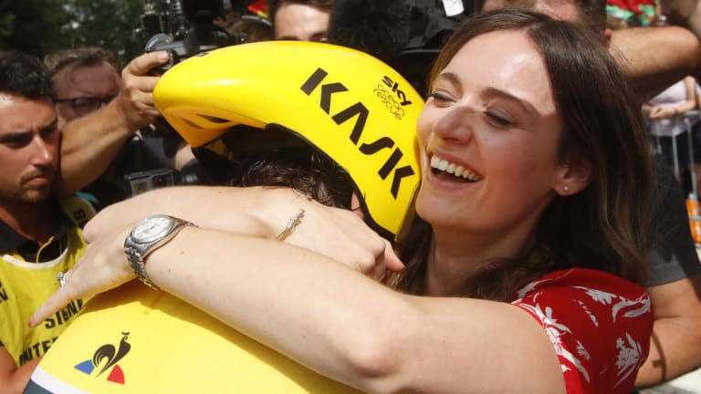 Special moment: Sarah Elen hugs husband Geraint Thomas, in a rendezvous the champion-in-waiting was not expecting.