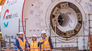 Vicki Ward MP shows French ambassador Christophe Penot, left, the Metro Tunnel boring machine.