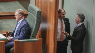 Treasurer Josh Frydenberg in discussions with Chris Bowen in Parliament.