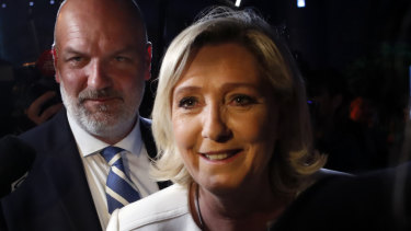Far-right National Party leader Marine le Pen, escorted by her bodyguard Thierry Legier, after she declared victory in the European Parliament election over pro-EU French President Emmanuel Macron.