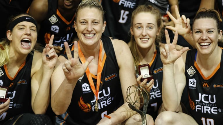 Suzy Batkovic of Townsville Fire celebrates with teammates  after winning the 2017/2018 WNBL championship in January.