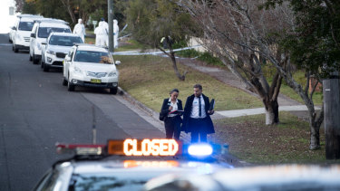 Police arrive on Friday morning to the scene where two teenagers were shot in their bedrooms.