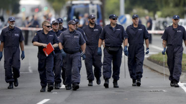 Police officers search the area near the Masjid Al Noor mosque after the terror attack in Christchurch.