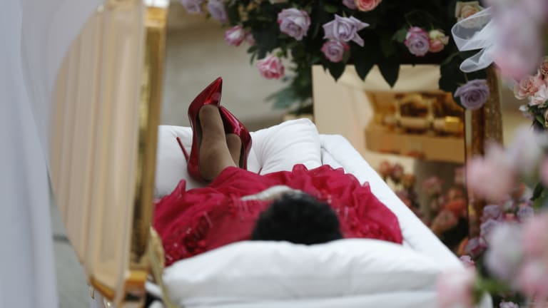 Aretha Franklin lies in her casket at Charles H. Wright Museum of African American History during a public visitation in Detroit.