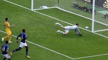 Australia's goalkeeper Mathew Ryan doesn't stop Paul Pogba's shot on goal.