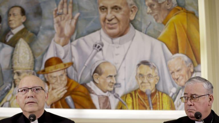 Members of Chile's bishops conference Luis Fernando Ramos Perez, left, and Juan Ignacio Gonzalez, met reporters at the Vatican.