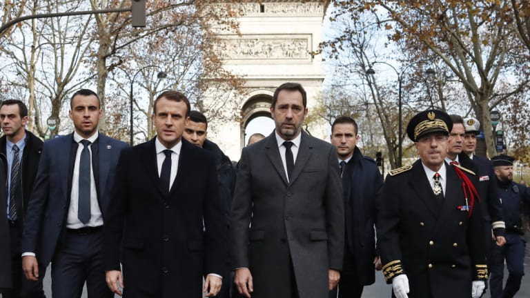 France's President Emmanuel Macron, Interior Minister Christophe Castaner, centre right, and Paris police Prefect Michel Delpuech, right, arrive to visit firefighters and riot police officers the day after a demonstration, in Paris.