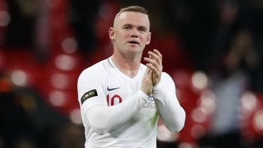 England's Wayne Rooney greets fans at Wembley Stadium.