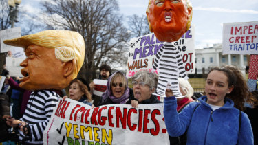 People gather in front of the White House on Presidents' Day to protest against Donald Trump declaring a national emergency along the southern border.