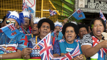 Local Fijian women wait for the arrival of Meghan, Duchess of Sussex at a market in Suva, Fiji.
