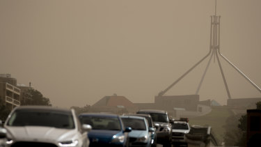 Strong winds blanket Parliament House in dust on Tuesday afternoon.
