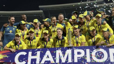 The Aussies celebrate with the trophy.