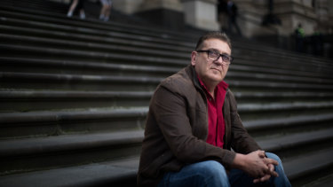 "Frank D'Abaco, the father of an autistic teen who said he was bashed unconscious by up to eight men, protests on the steps of Parliament over what the family perceive as government inaction on ""gangs"" in Melbourne's suburbs."