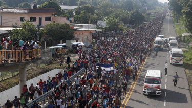 Central American migrants walking to the US start their day departing Ciudad Hidalgo, Mexico, on Sunday.