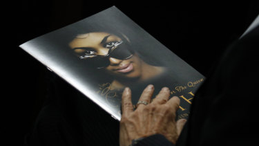 A person holds a program during the funeral service for Aretha Franklin.