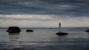 As the storm clouds roll in, one fisherman finds peace on a Williamstown beach.
