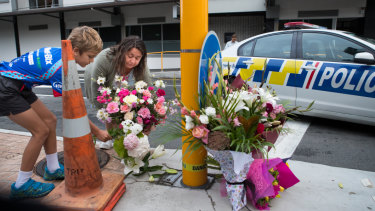 Locals lay flowers at the Masjid Al Noor Mosque in Christchurch.