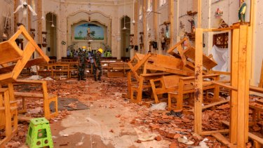 Sri Lankan soldiers inspect the damage inside St. Sebastian's Church where a bomb blast took place in Negombo, Sri Lanka.