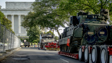 Two Bradley Fighting Vehicles are parked near the Lincoln Memorial in Washington ahead of Independence Day.