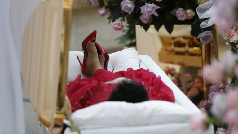 Aretha Franklin lies in her casket at Charles H. Wright Museum of African American History during a public viewing in Detroit.