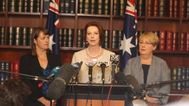 Julia Gillard, flanked by Nicola Roxon and Jenny Macklin, announce the commissioners for the royal commission into child sexual abuse in January 2013.