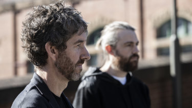 Atlassian co-chief executives Scott Farquhar (foreground) and Mike Cannon-Brookes said the business is going through what may be a challenging transition for customers.
