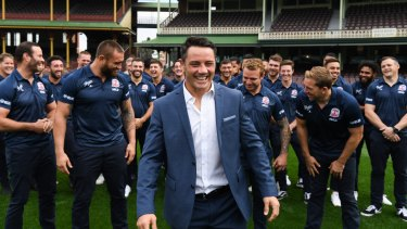 Team man: Cooper Cronk with his Roosters teamates after announcing he will retire at the end of the season.