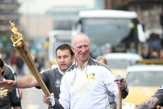 NEWCASTLE-UPON-TYNE, UNITED KINGDOM - JUNE 15:  In this handout image provided by LOCOG, Torchbearer 117 Jack Charlton carries the Olympic torch on June 15, 2012 in Newcastle upon Tyne, England. The Olympic Flame is now on day 28 of a 70-day relay involving 8,000 torchbearers covering 8,000 miles.  (Photo by LOCOG via Getty Images) FILE PHOTO